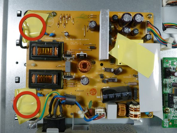 Remove the two pieces of yellow tape on the left side of the power supply.