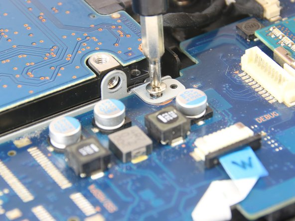 Use a Phillips #0 screwdriver to remove the six 4.5mm screws holding the motherboard to the case.