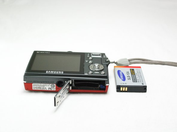 Open the battery cover on the bottom of the camera and carefully remove the battery.