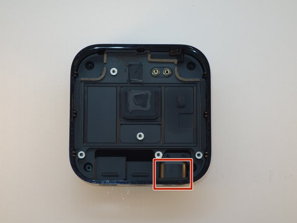 Pull the power port away from the side of the casing.