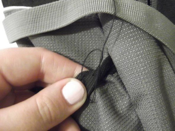 End the stitch by tying a small knot close to where the thread passes through the fabric.