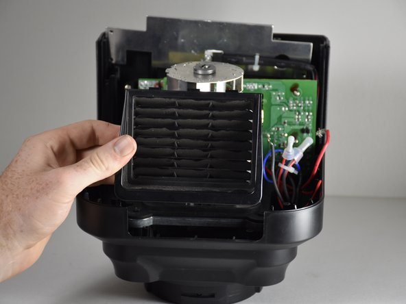 Grip the vent on either side and lift  it straight in the upward direction.