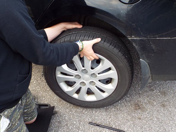Be aware that the tire will shift as lug nuts are removed.