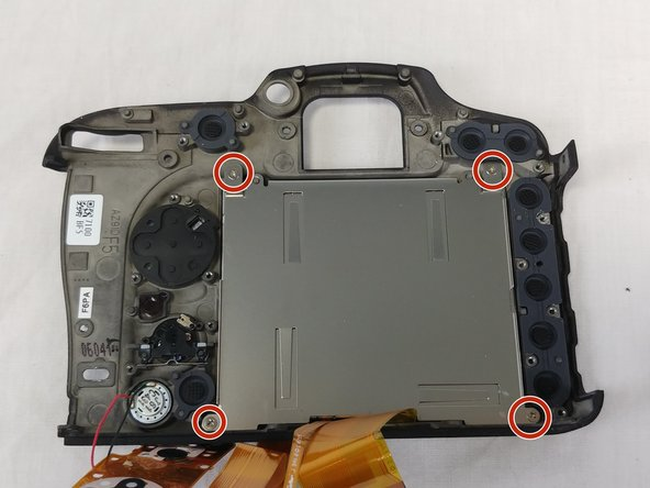 Then unscrew the remaining screws holding the back plate to the LCD.