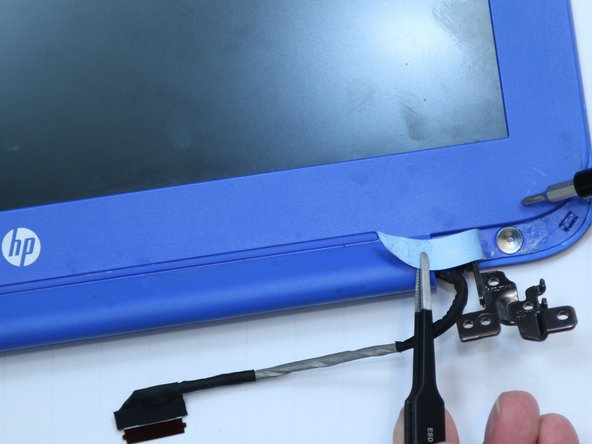 Remove two 2 millimeter bezel screws using a #00 Phillips screwdriver.