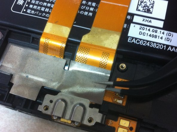 Image 1/3: Use the tweezers to remove the tape to show the connection.