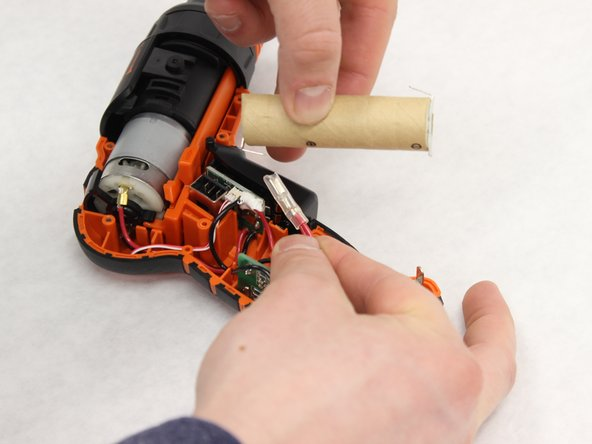 Detach the contact by pulling the contact away from the battery.