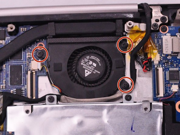 Remove the 3 (4mm) fan screws with a  Phillips #0 Screwdriver