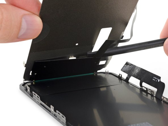 Raise the LCD shield up at a higher angle, until you can see the rest of the display cable stuck to the back.
