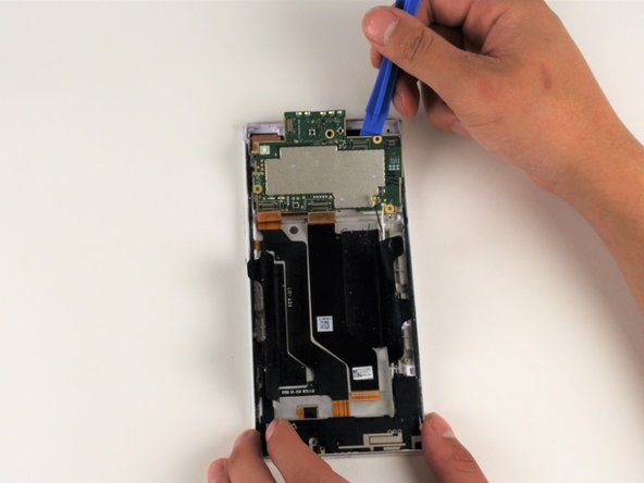 Lift up with your iFixit Opening Tool to lift the motherboard from the device.