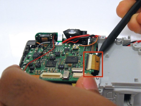 Next, use the spudger to remove the pictured ribbon from the ZIF connector.