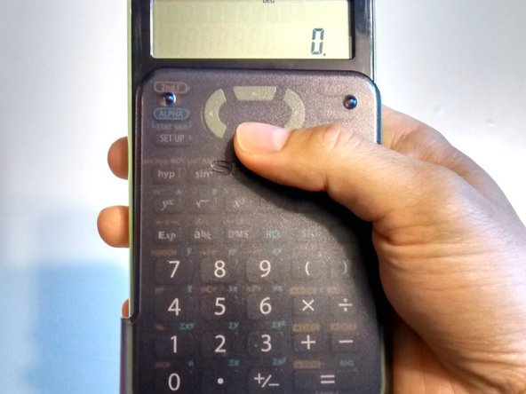 Image 2/3: Slide the grey protective case, short side facing down, from the bottom to the top of the calculator, ensuring the case slides easily along the two channels on the calculator body.