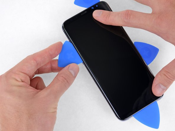 Use your picks as needed to finish separating the adhesive beneath all areas of the display.