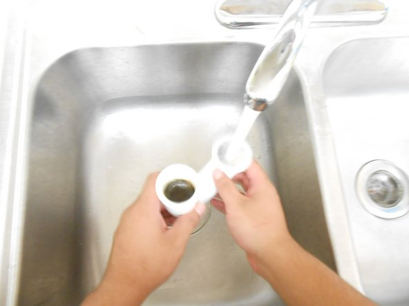 Do NOT rinse the P-trap in the sink you are working on because there is no connecting pipe to catch the water.