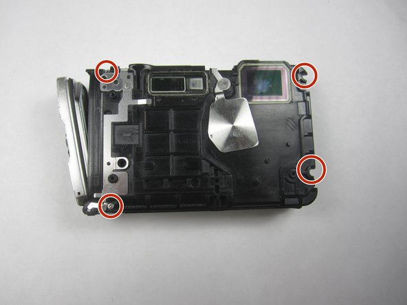Remove four screws (9.4mm) on the front of the camera using a Phillips #000