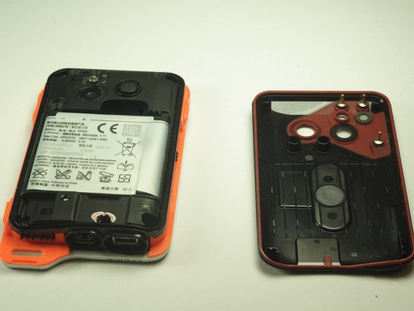 Remove the battery shield with the plastic opening device.