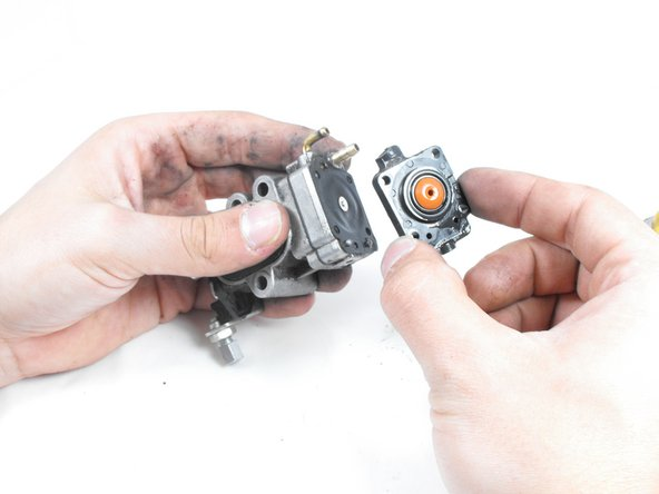 Once the screws are removed, the rest of the carburetor should separate easily.