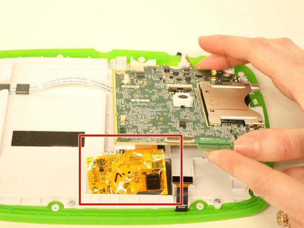 Image 1/2: Disconnect the orange sheet from the motherboard by lifting the metal tab on the connector (as you did for the cables  in steps 1 and 2), and lift the motherboard completely out of the device.