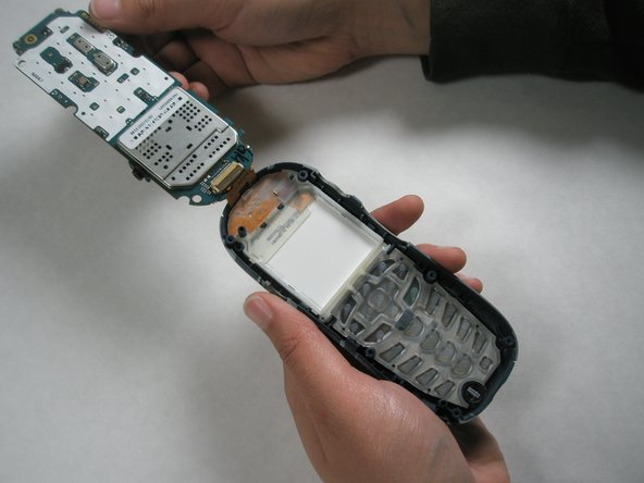 Image 2/2: Note: Do not try to completely remove the circuit board from the phone as it will be connected to the electrical strip at the top of the phone.
