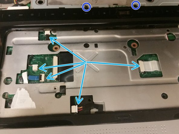 Remove the two screw covers on the screws under where the disc drive faceplate was, and then remove each M2.5x4 screw.