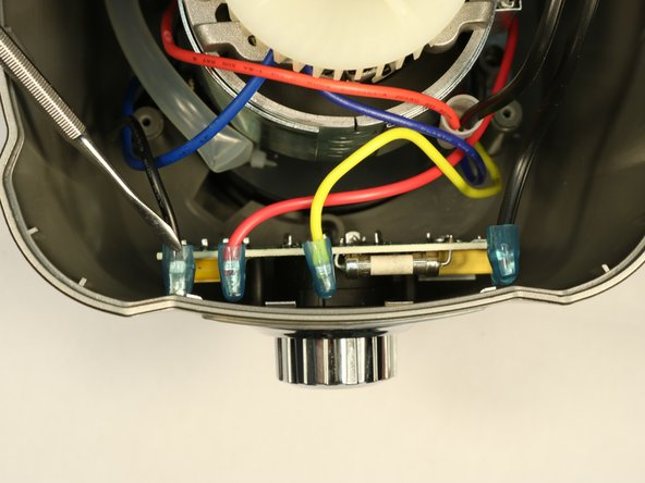 Remove the 2 black, yellow, and red wires from circuit board by push down on the tab to release and then pull up.