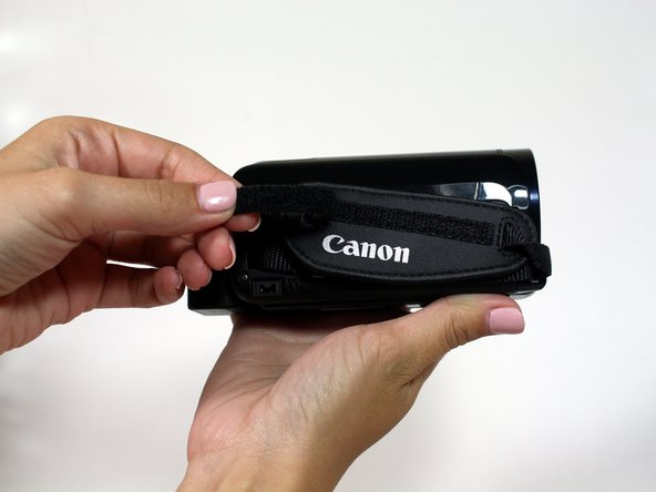 Pull up the Velcro strap starting from the front of the camera and working your way towards the back.