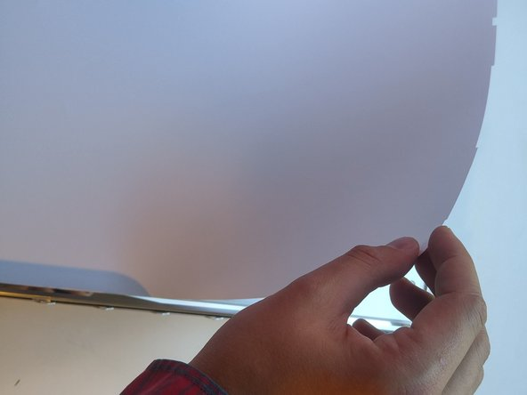 Image 1/3: Place your fingers on the sides of the glass panel and lift it upwards to remove it