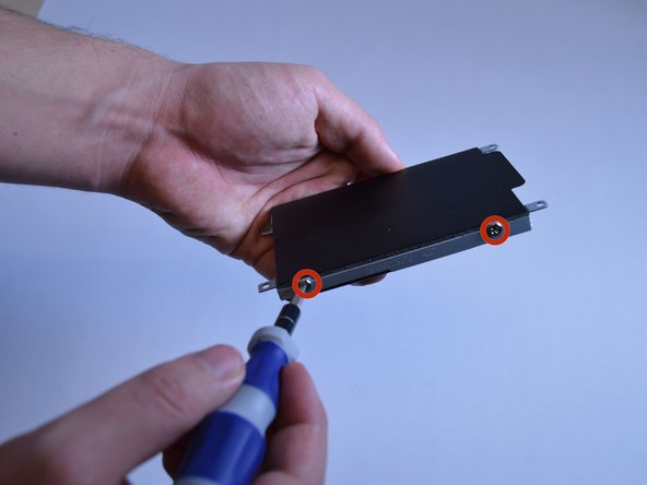 Image 1/1: Use a Phillips #0 screwdriver to remove the screws.