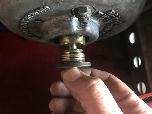 Pull the bolt and washers out.