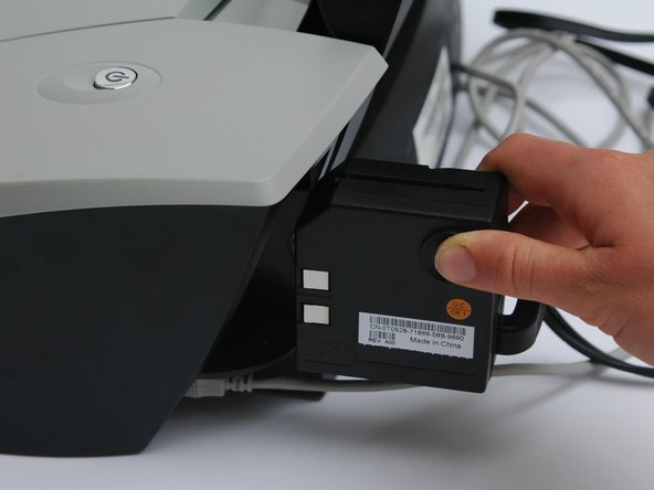 Image 3/3: Pull outwards until the power adapter is disconnected from the printer.