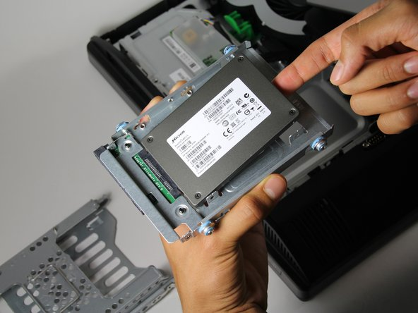 "Remove the four 5/16"" side screws, with the T15 Torx Screwdriver, and gently take out the drive."