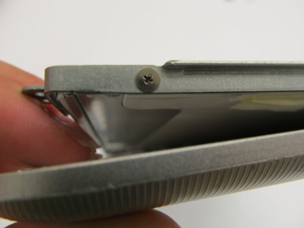 Use a metal spudger to partially remove the screen from the plastic case.
