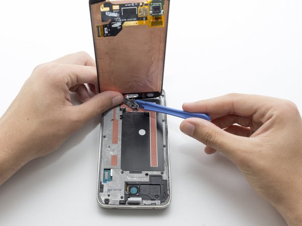 Use the plastic opening tool to pry the home button off. Moderate force is required.