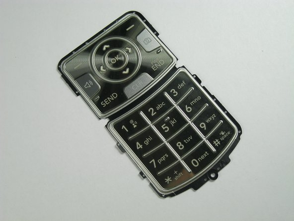 Insert the replacement keypad.