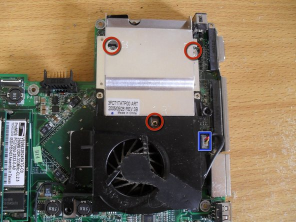 Remove the three screws holding the heatsink to the mother board (silver coloured 4mm screws)