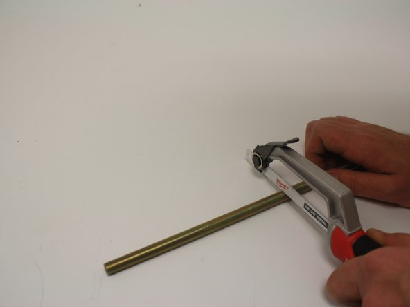 Using a metal hacksaw, cut the rod where the mark was made. Remember to measure twice, cut once.