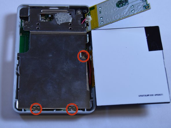 Use a Phillips Head screwdriver to unscrew the three 3/16 inch screws that were underneath the LCD screen.