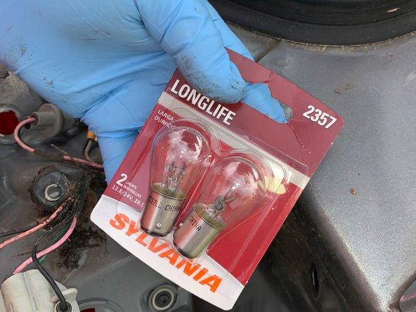 Put a new Sylvania long life bulb into the socket until you hear it click.