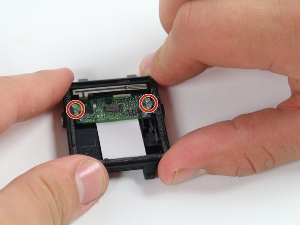 Image 1/2: Make an effort not to damage any nearby components of the motherboard with the screwdriver.