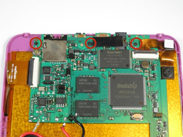 Use a philips #00 screwdriver to unscrew the three 4.064mm screws which attach the motherboard to the front of the device.