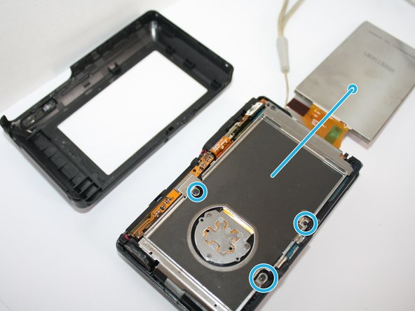 Now that you have the back casing off, gently remove the LCD screen up and to lay on top of the table to the right.