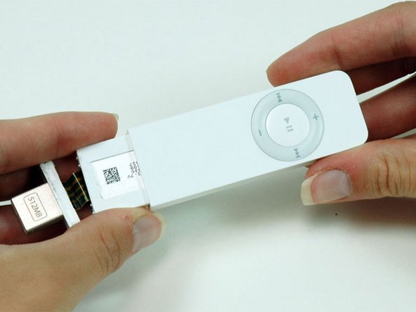 Turn the iPod so that the click wheel is facing up. This will prevent the battery indicator from falling out.