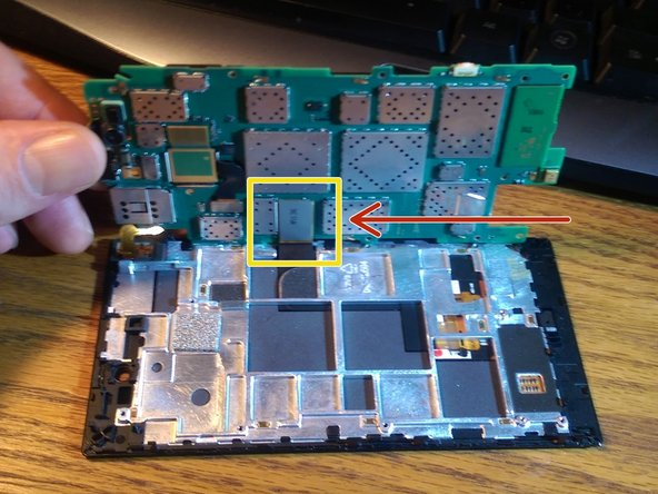 The area in yellow is the only connection on the underside of the motherboard that needs to be freed up.  This is the display connection.
