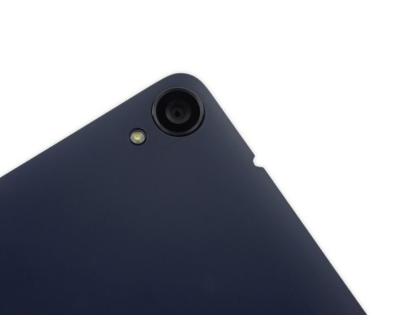 Image 1/2: The rear-facing camera is situated near the top right corner of the rear case, while the front-facing camera sits dead center at the top, near one of two front-facing speaker grilles.
