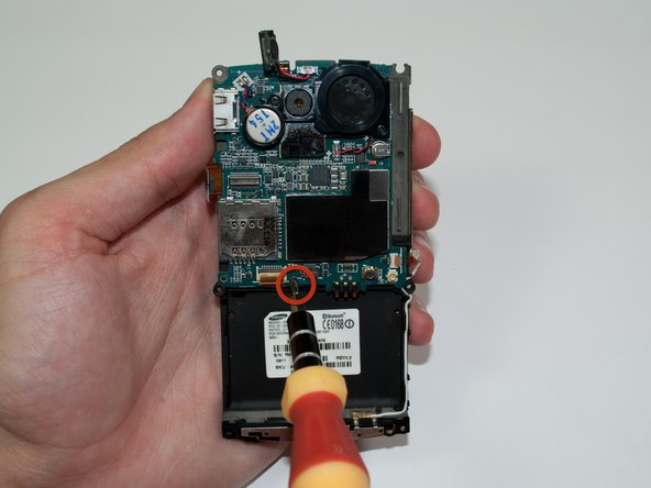 Using a Phillips #00 screwdriver, remove the 3.5 mm screw at the bottom center of motherboard.