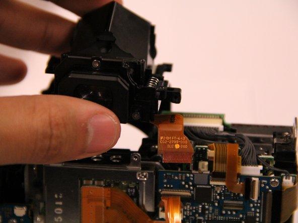 Image 2/2: Remove the orange ribbon cable.