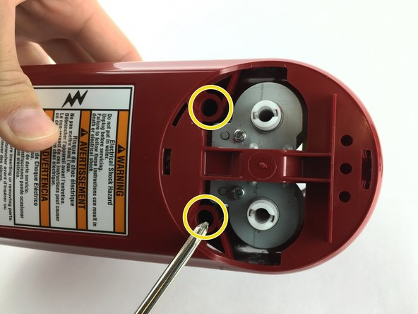 Use a Phillips 2 screwdriver to remove the two 20.0mm screws holding the bottom plastic piece on.