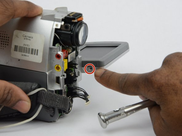 There is a 2.7 mm screw on the  LCD monitor where the monitor is connected to the main body of the camcorder. Remove the 2.7 mm screw.