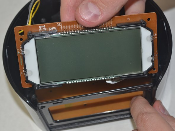 Once the four 5.5 mm Phillips #00 face panel screws come out, slide the screen out vertically. Set the screen aside.