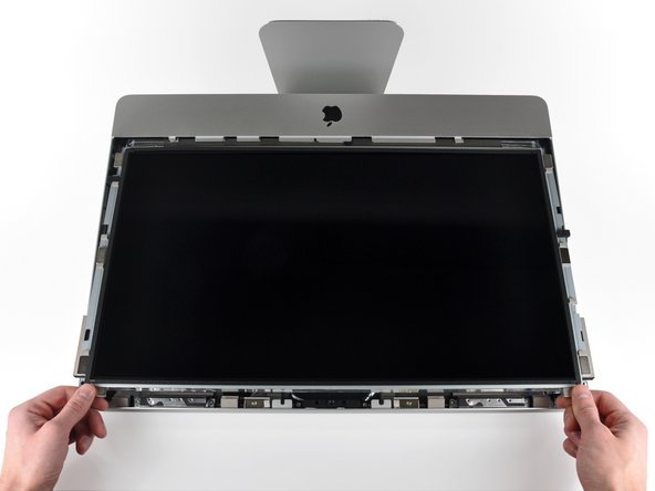 Image 1/1: Slightly lift the top edge of the display out of the outer case.